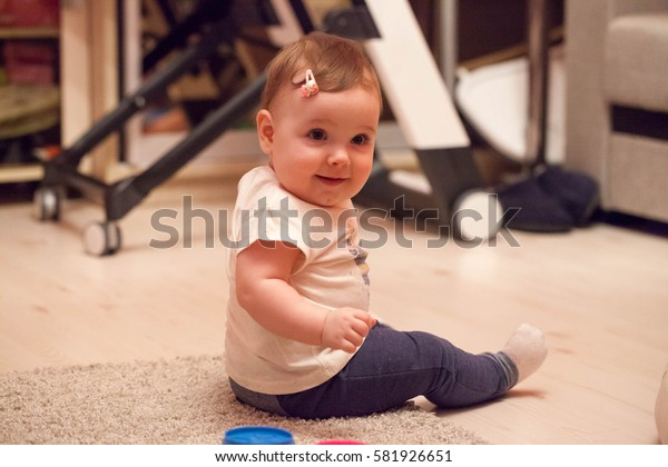 Portrait of a little baby girl with a barrette in her hair
