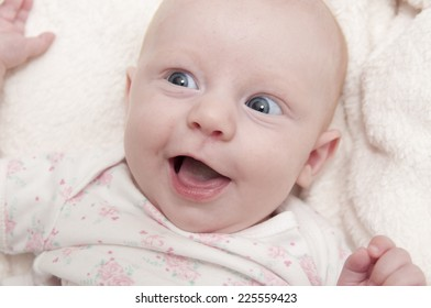 Portrait of a little baby girl smiles and happy