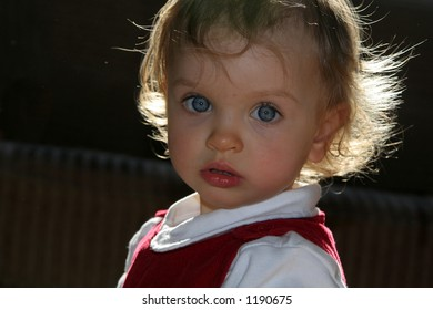 Portrait of a little baby in sunlight