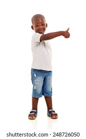 portrait of little black boy with thumb up