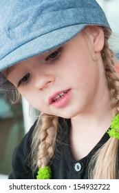 Portrait of little blond girl