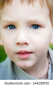 Portrait Little Boy with blue eyes, selective focus