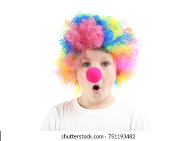 Portrait of little boy clown on white background