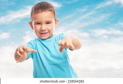 portrait of a little boy doing an animal gesture