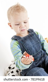 portrait of little boy eating chocolate