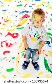 Portrait of a little boy enjoying his painting. Education.