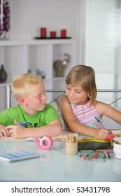 Portrait of a little boy and a little girl doing homework