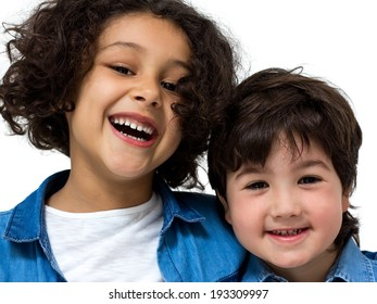 Portrait of a little boy and girl on a white background