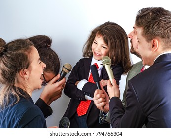 Portrait of a little boy has an interview in the microphone in the studio, entertainment and art, indoor