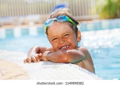 Portrait of little boy having fun in swimming pool