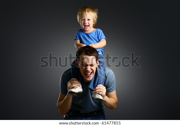 The portrait of a little boy and his father