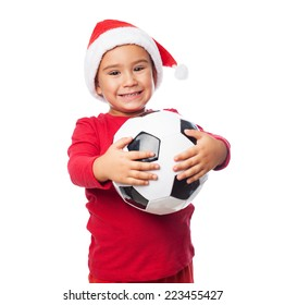 portrait of a little boy holding a football ball on christmas day