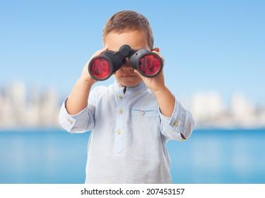 portrait of a little boy looking through the binoculars