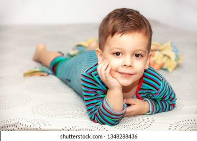 Portrait little boy on bed