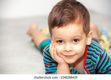 Portrait little boy on bed