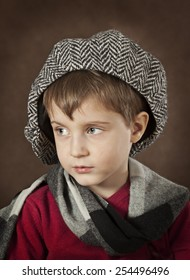 Portrait of a little boy on a brown background