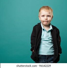 portrait of a little boy on a green background.