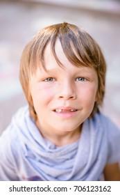 portrait of little boy outdoors in public park
