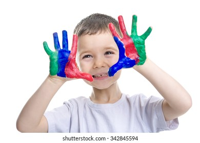 A Portrait of little boy with paints on hands isolated on white background