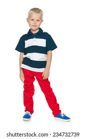 A portrait of a little boy in a red pants on the white background