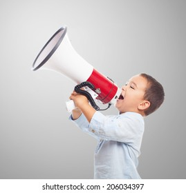 portrait of a little boy shouting with the megaphone