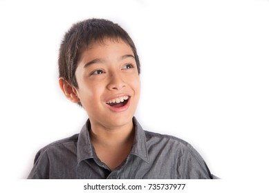 Portrait of little boy with smile and handsome face looking up side