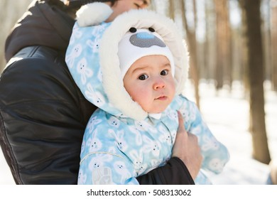 Portrait of little boy in snowy landscape