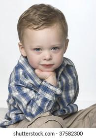 Portrait of a little boy in a studio setting.