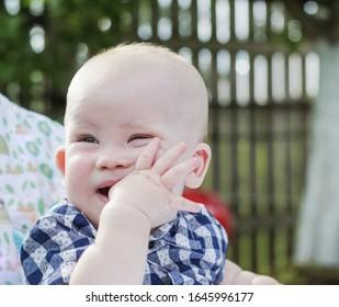 Portrait of a little boy sucking a finger
