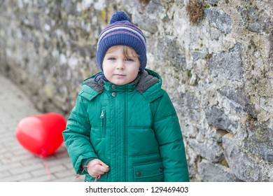 Portrait of little boy of two years in warm clothes outdoor