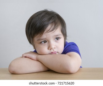 Portrait of little boy with upset, sad face