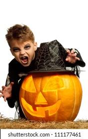 Portrait of little boy wearing halloween costume with pumpkin on white background