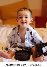 Portrait of a little cheerful baby wearing a traditional yukata in a ryokan's room in Takayama city.