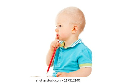 portrait of little child boy holding a pencil