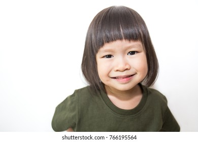 Portrait of little cute asian girl isolated on white background. Education concept
