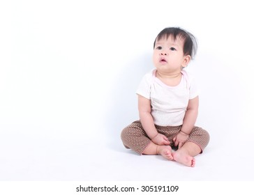 Portrait of little cute baby on a white background