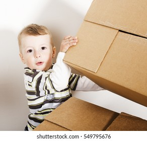 portrait of little cute boy playing with box, lifestyle people concept