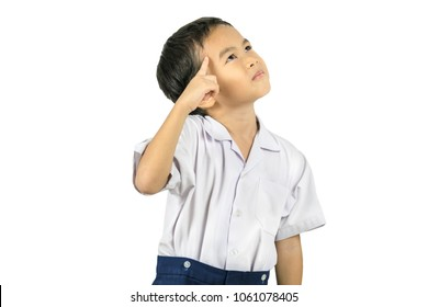 Portrait of little cute boy standing on a white background
