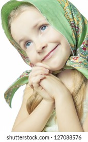 portrait of little cute girl in bright color scarf smiling and gesturing