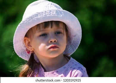 Portrait of a little cute girl with a pensive look