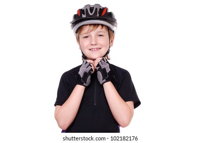Portrait of a little cyclist  in a helmet
