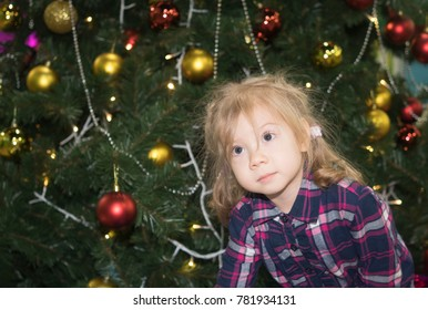 portrait of a little girl 3 years near the Christmas tree
