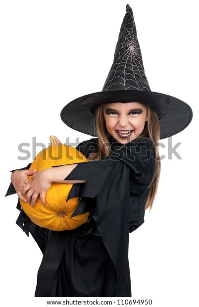 Portrait of little girl in black hat and black clothing with pumpkin on white background