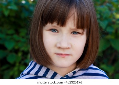 Portrait of a little girl with blue eyes