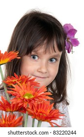 portrait of the little girl with bouquet of flower