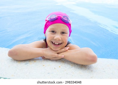 portrait of  little girl by the side of the pool