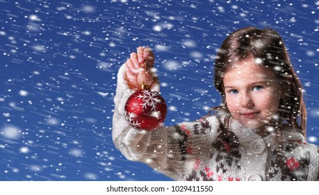 Portrait of little girl with Christmas ball
