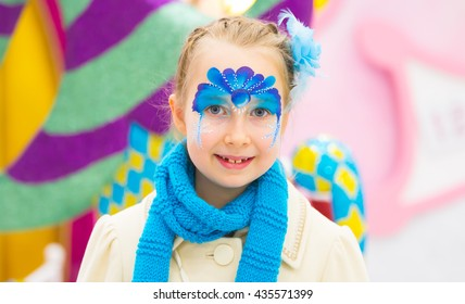 Portrait of little girl with Christmas face painting