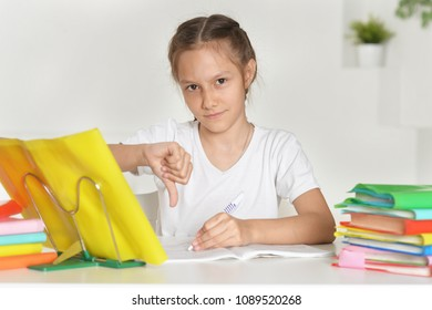 portrait of little girl does not want lessons