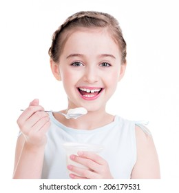 Portrait of a  little girl eating yogurt - isolated on white.